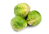 Trio of fresh raw uncooked brussels sprouts, brassica oleracea.