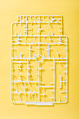 sprue or injection moulding of toy on yellow background