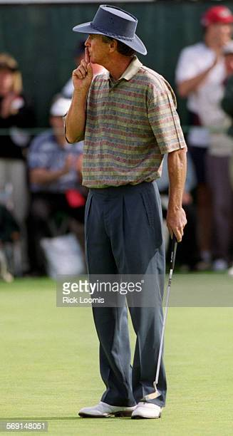 SPtoshibagreenshhh0314RL––Newport Beach––Hubert Green quiets the crowd after putting on the 18th green of the Toshiba Senior Classic Saturday...