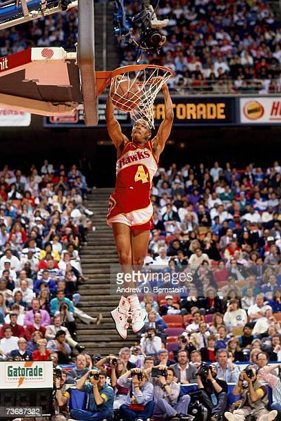 Spud Webb of the Atlanta Hawks attempts a dunk during the 1988 Slam Dunk Contest on February 6 1988 at Chicago Stadium in Chicago Illinois NOTE TO...