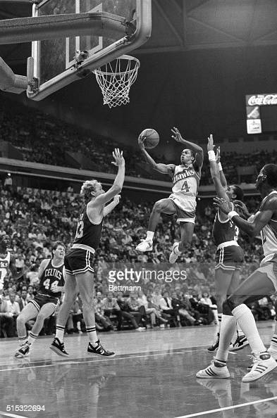 Spud Webb the 5foot 7inch guard for the Atlanta Hawks flies past Celtic defenders Larry Bird and Dennis Johnson on his way to two points during 2nd...