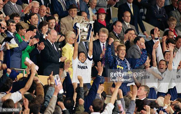 Spurs captain Gary Mabbutt lifts the FA Cup as Lady Diana Princess of Wales Prince Charles Bert Millichip Duchess of kent and Graham Kelly look on...