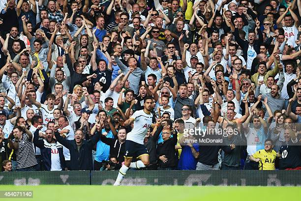 Spurs fans celebrate the opening goal by Nacer Chadli of Spurs during the Barclays Premier League match between Tottenham Hotspur and Queens Park...