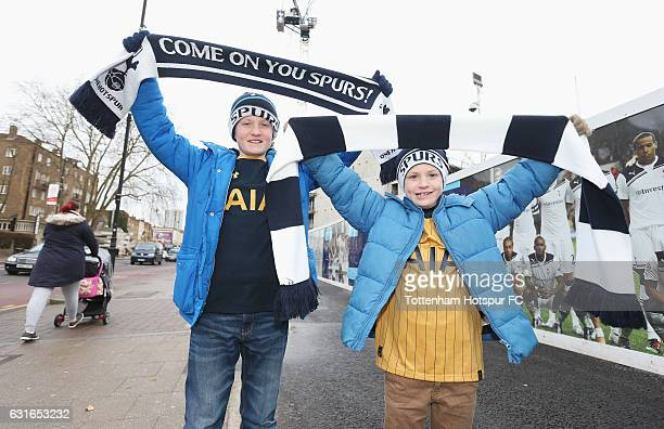 Spurs fans pose outside the ground prior to the Premier League match between Tottenham Hotspur and West Bromwich Albion at White Hart Lane on January...