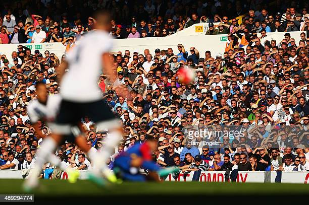 Spurs fans shield their eyes from the sunlight during the Barclays Premier League match between Tottenham Hotspur and Crystal Palace at White Hart...