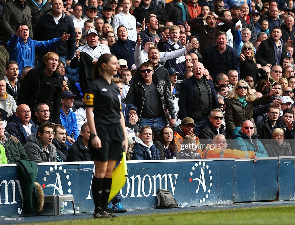 Spurs fans shoyut appeals to assitant referee Sian Massey in action during the Barclays Premier League match between Tottenham Hotspur and Everton at White Hart Lane on April 7, 2013 in London, England.