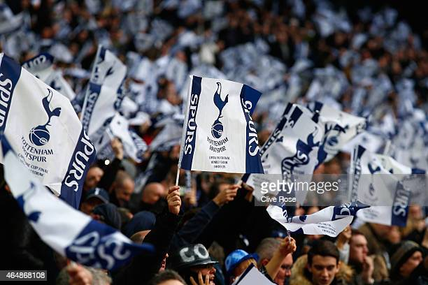 Spurs fans wave their flags during the Capital One Cup Final match between Chelsea and Tottenham Hotspur at Wembley Stadium on March 1 2015 in London...