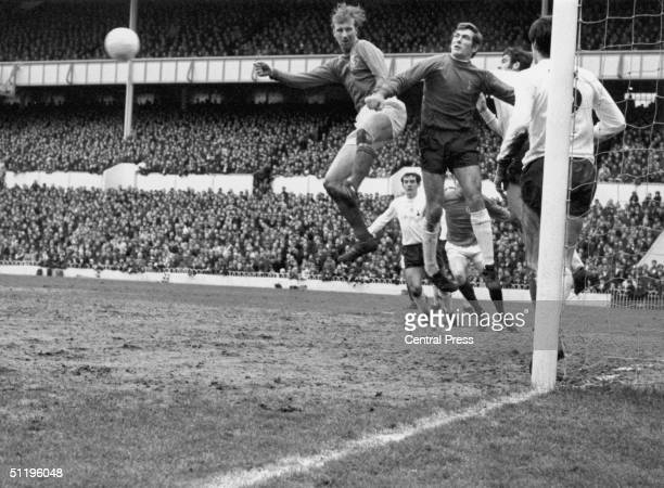 Spurs goalkeeper Pat Jennings punches away a header from Leeds centre half Jack Charlton during a game at Tottenham Hotspur's home ground White Hart...
