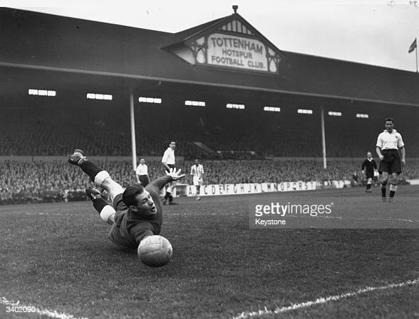 Spurs goalkeeper Ted Ditchburn makes a dramatic save at full stretch from an Arsenal shot as Tottenham Hotspur play Arsenal in a London derby match...