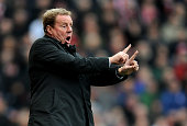 Spurs manager Harry Redknapp gestures instructions to his players during the Barclays Premier League match between Stoke City and Tottenham Hotspur...
