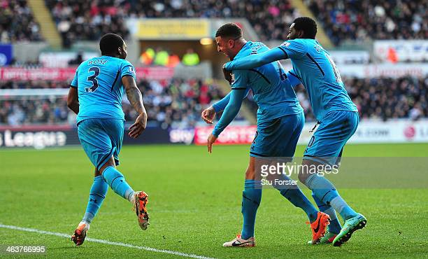Spurs player Kyle Walker celebrates the second Spurs goal with team mates Danny Rose and Emmanuel Adebayor during the Barclays premier league match...