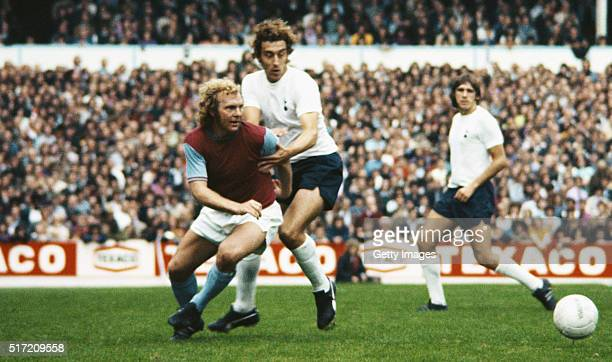 Spurs player Martin Chivers challenges West Ham United captain Booby Moore during a Division One match between Tottenham Hotspur and West Ham United...