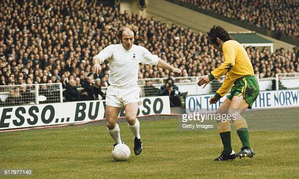 Spurs player Ralph Coates runs at Norwich defender Geoff Butler during the 1973 League Cup Final between Tottenham Hotspur and Norwich City at Wembey...