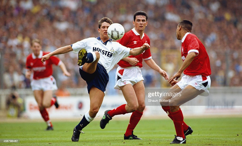 Spurs striker Gary Lineker holds off the challenge of Notts Forest players Steve Chettle and Des Walker during the 1991 FA Cup Final between...