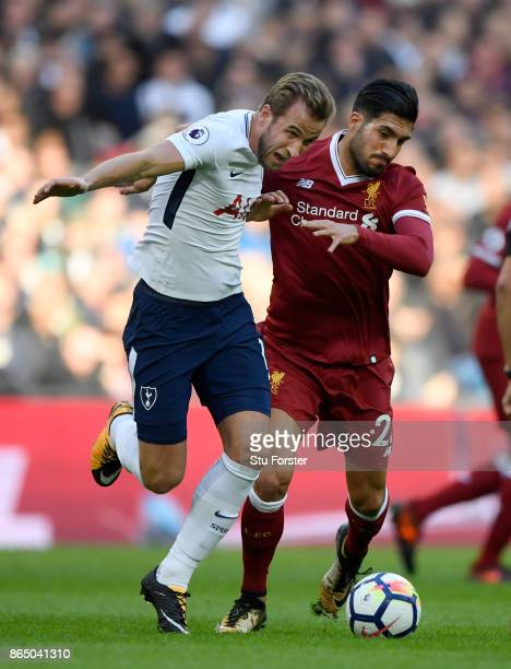 Spurs striker Harry Kane is challenged by Emre Can of Liverpool during the Premier League match between Tottenham Hotspur and Liverpool at Wembley...