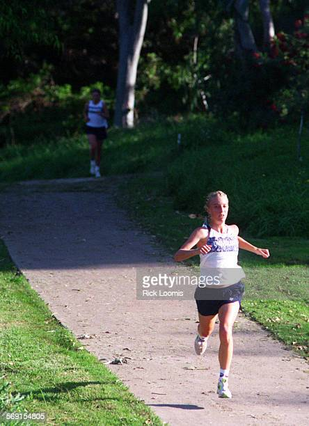 SPXcountry#21023RL–KODAK–Irvine– University's Allison Marquand runs toward her first place finish during a meet with Aliso Niguel at William R Mason...