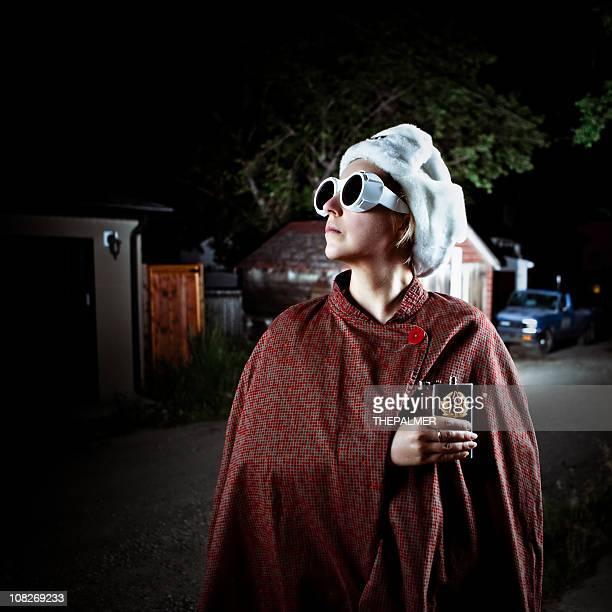 spy undercover on a dark alley