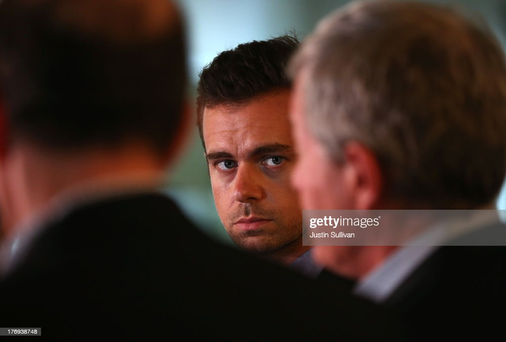 Sqaure CEO Jack Dorsey (C) looks on as Senate Finance Committee Chairman Max Baucus (R) (D-MT) and House Ways and Means Committee Chairman Dave Camp (L) (R-MI) speak to reporters while touring the Square headquarters on August 19, 2013 in San Francisco, California. Senators Max Baucus (D-MT) and Dave Camp (R-MI) continued their Tax Reform Tour with a visit to the headquarters of mobile payment company Square. The tour is taking the two senators across the nation to speak to American people about how to fix the nation's broken tax code to benefit families and job creators.
