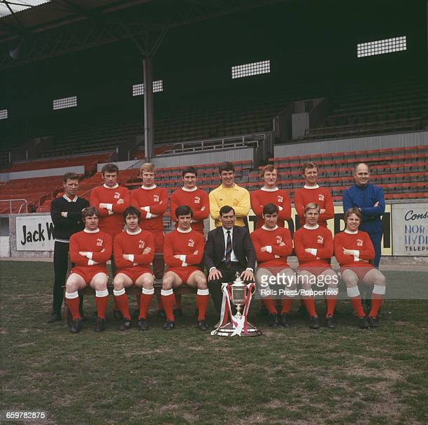Squad and team members of Aberdeen Football Club posed with the Scottish Cup at Pittodrie Stadium in Aberdeen after defeating Celtic in the final 31...
