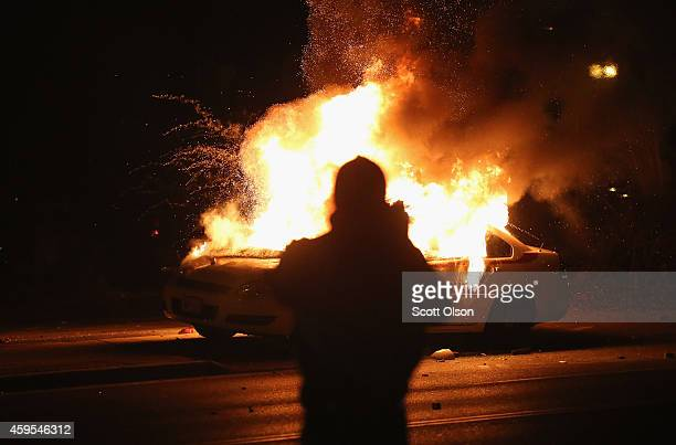 A squad car burns after protestors rioted following the grand jury announcement in the Michael Brown case on November 24 2014 in Ferguson Missouri...