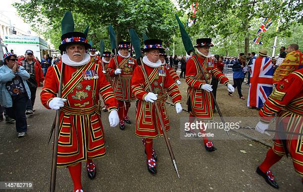 A squad of Beefeaters pass spectators to get to their correct position at the end of the Mall during the Diamond Jubilee celebrations on June 5 2012...