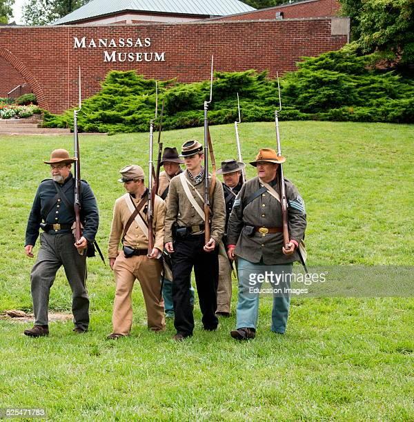 Squad of men in Confederate uniforms drill in Civil War reenactment Manassas Virginia