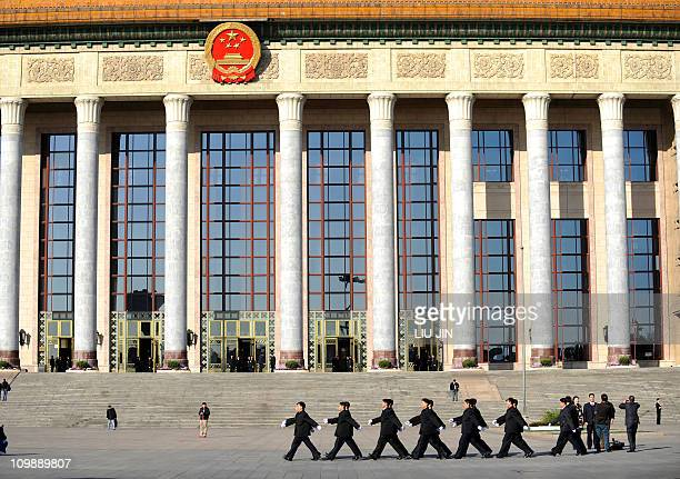 A squad of security personnel march during the National People's Congress in front of the Great Hall of the People in Beijing on March 9 2011 After...