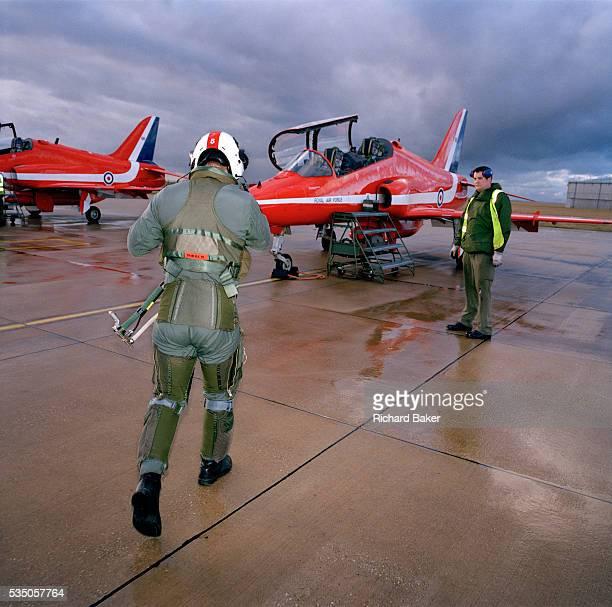 Squadron Leader Duncan Mason of the elite 'Red Arrows' Britain's prestigious Royal Air Force aerobatic team strides out across a gloomy rainswept...
