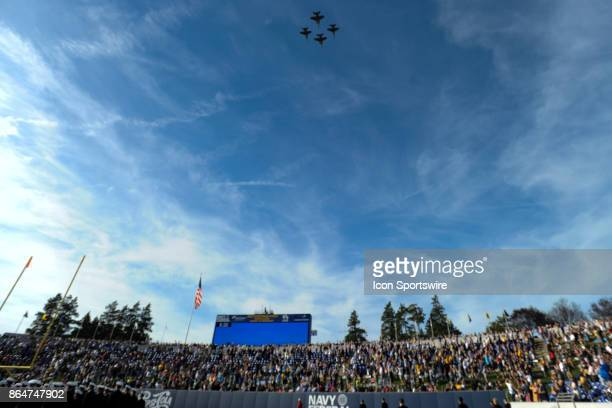 A squadron of jet flies over Navy Marine Corps Memorial Stadium in Annapolis MD on October 21 2017