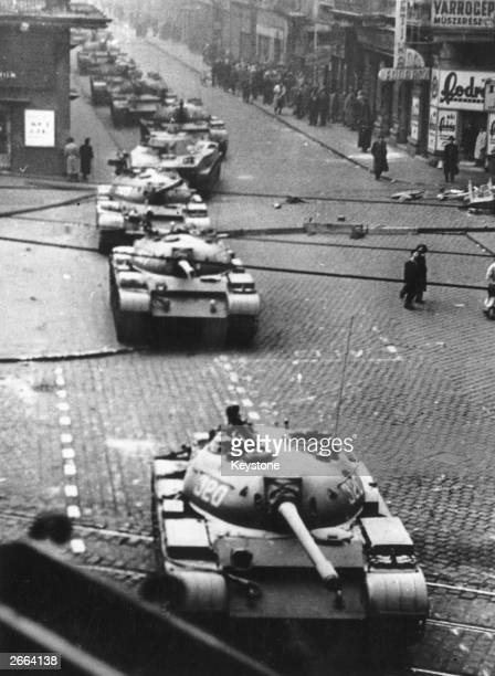 A squadron of Russian T55 main battle tanks rumbling down a street in Budapest during Russia's invasion of Hungary