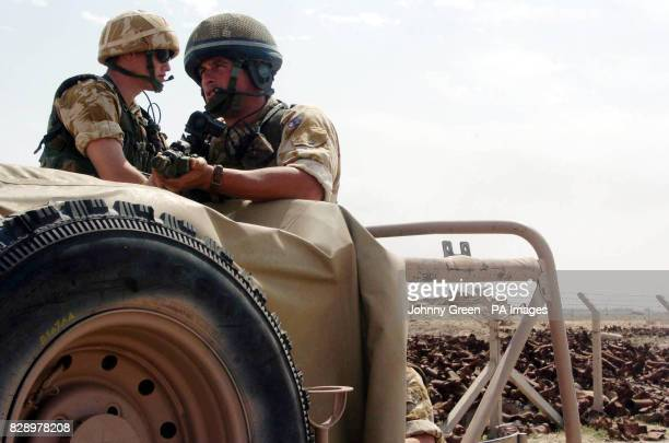 II Squadron RAF Regiment's Corporal Steve Wall from Stevenage and Senior Aircraftsman David Bailey patrol an arms dump near Basra in southern Iraq...