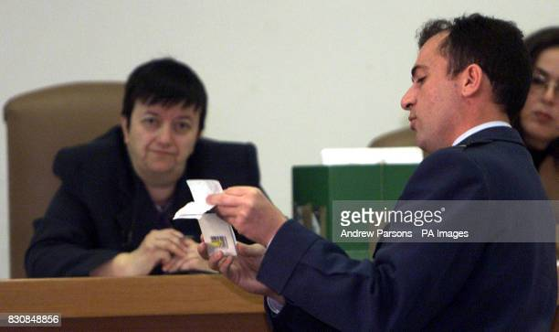 Squardron Leader Nektarios Samaras an officer with the Greek air force shows some evidence during the trial in Kalmata Greece of the 12 British...
