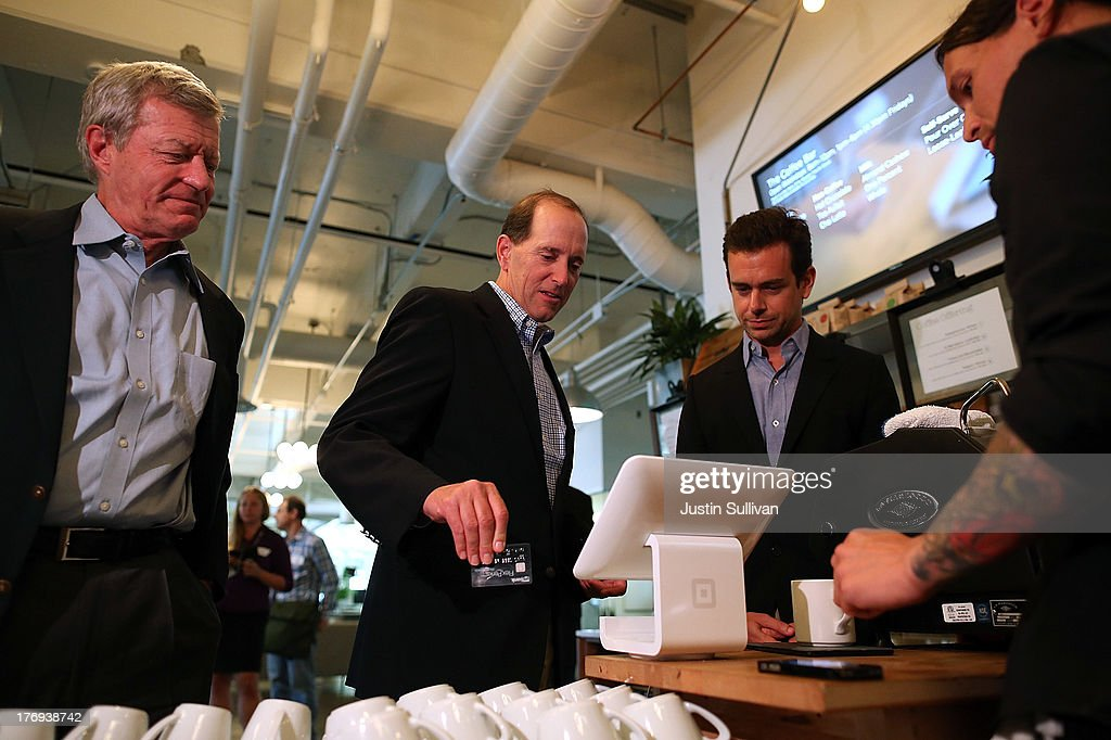 Square CEO <a gi-track='captionPersonalityLinkClicked' href=/galleries/search?phrase=Jack+Dorsey&family=editorial&specificpeople=5818892 ng-click='$event.stopPropagation()'>Jack Dorsey</a> (R) demonstrates the Square payment system for House Ways and Means Committee Chairman Dave Camp (C) (R-MI) and Senate Finance Committee Chairman <a gi-track='captionPersonalityLinkClicked' href=/galleries/search?phrase=Max+Baucus&family=editorial&specificpeople=242972 ng-click='$event.stopPropagation()'>Max Baucus</a> (L) (D-MT) while touring the Square headquarters on August 19, 2013 in San Francisco, California. Senators <a gi-track='captionPersonalityLinkClicked' href=/galleries/search?phrase=Max+Baucus&family=editorial&specificpeople=242972 ng-click='$event.stopPropagation()'>Max Baucus</a> (D-MT) and Dave Camp (R-MI) continued their Tax Reform Tour with a visit to the headquarters of mobile payment company Square. The tour is taking the two senators across the nation to speak to American people about how to fix the nation's broken tax code to benefit families and job creators.