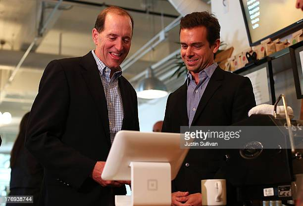 Square CEO Jack Dorsey demonstrates the Square payment system for House Ways and Means Committee Chairman Dave Camp while touring the Square...