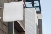 Horizontal front view of empty square signage on a building with modern architecture