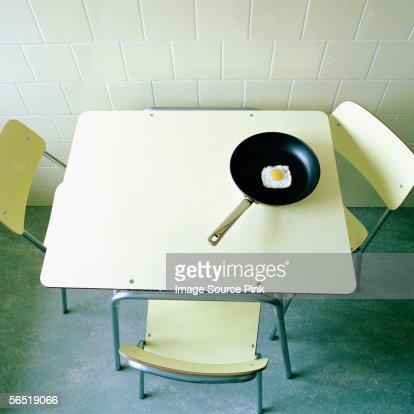 Square fried egg on table : Stock Photo