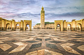 Huge empty square with paved  on the ground in front of the Minarett of Hassan II Mosque.