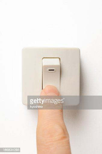 Square light switch with finger on white background stock