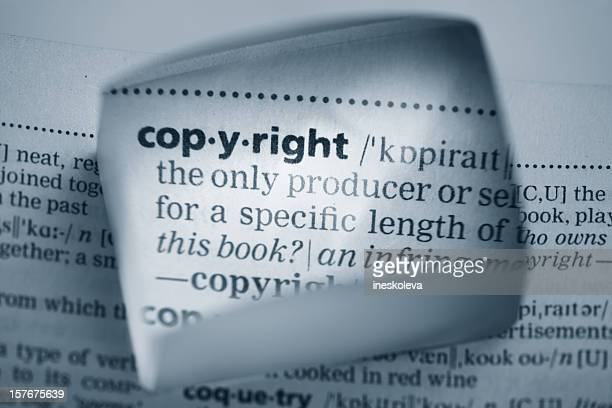A square magnifier showing the definition of copyright