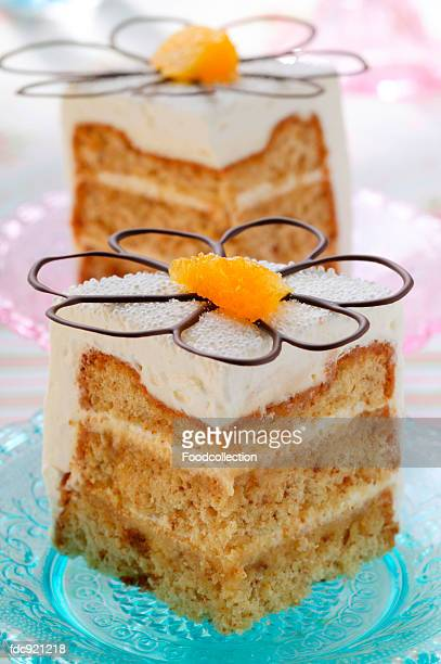 Square of cake with cream icing and chocolate orange flower