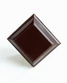 Square of dark chocolate.