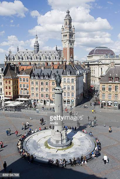 Square 'place du General de Gaulle' with the Column of the Goddess in the foreground and the belfry of the Chamber of Commerce in the background
