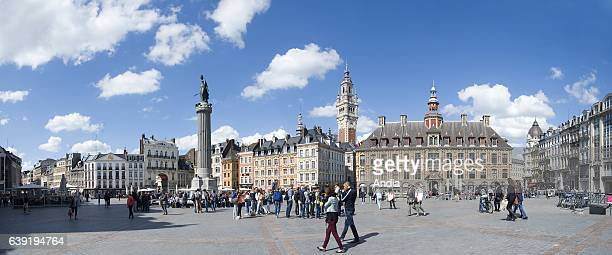 Square 'place du General de Gaulle' with the Column of the Goddess on the left and the belfry of the Chamber of Commerce in the background