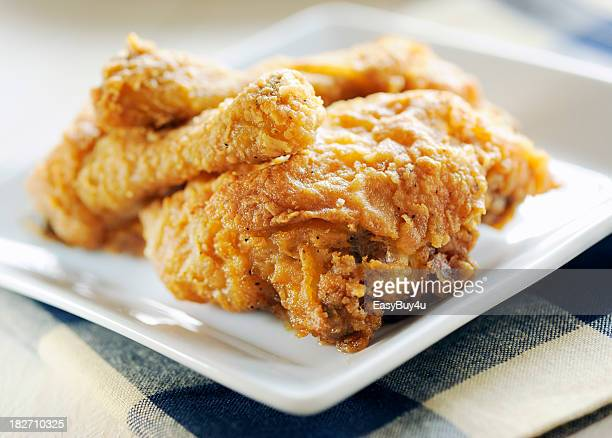 A square plate of fried chicken