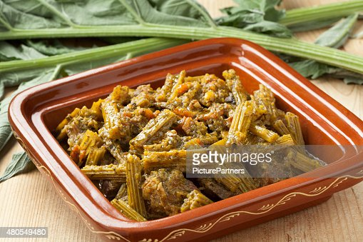 Square tajine with meat and cardoon meal : Stock Photo