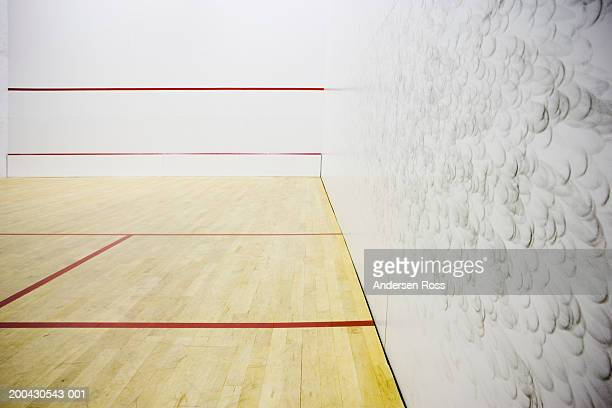 Squash court with scuff marks from ball on wall