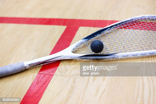 squash racket and ball on the court : Stock Photo
