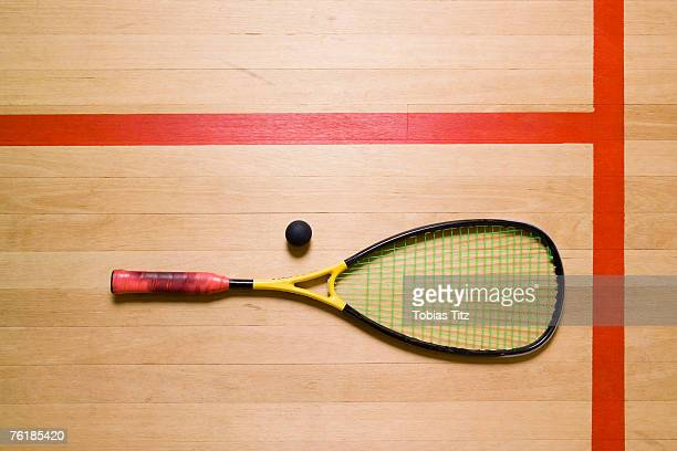 A squash racquet and ball