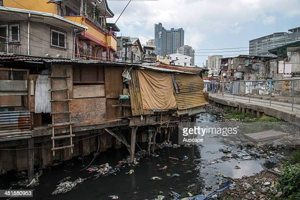 A squatter settlement along a canal about 20 million people live in slums in the Philippines Manila Philippines