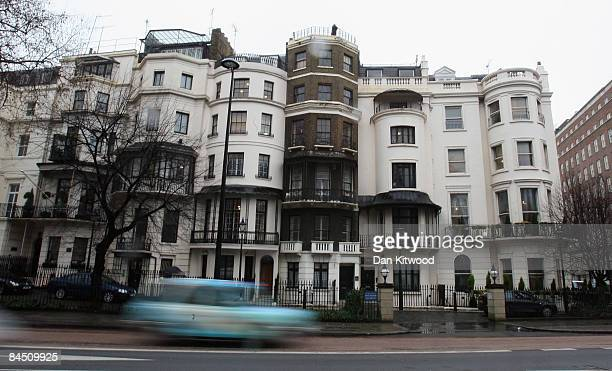 A squatter stands on the roof of one of the two Mayfair mansions estimated to have a combined value of £23 million GBP that have been taken over on...